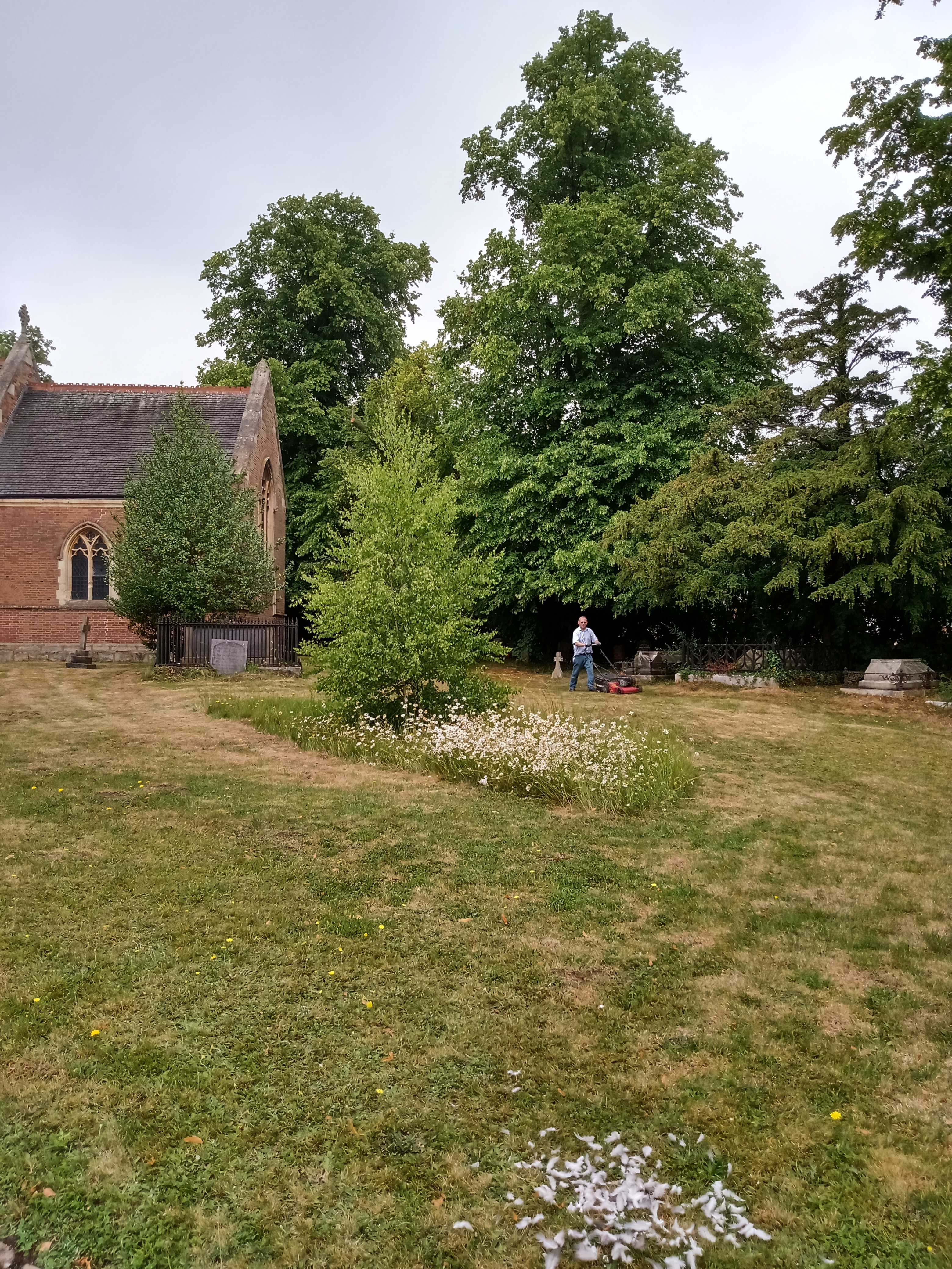 Mike mowing the lawns of the church grounds.